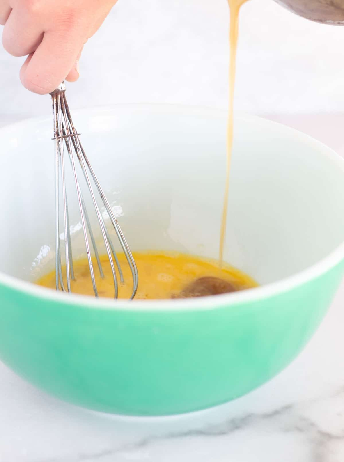 slowly whisking the filling into the eggs