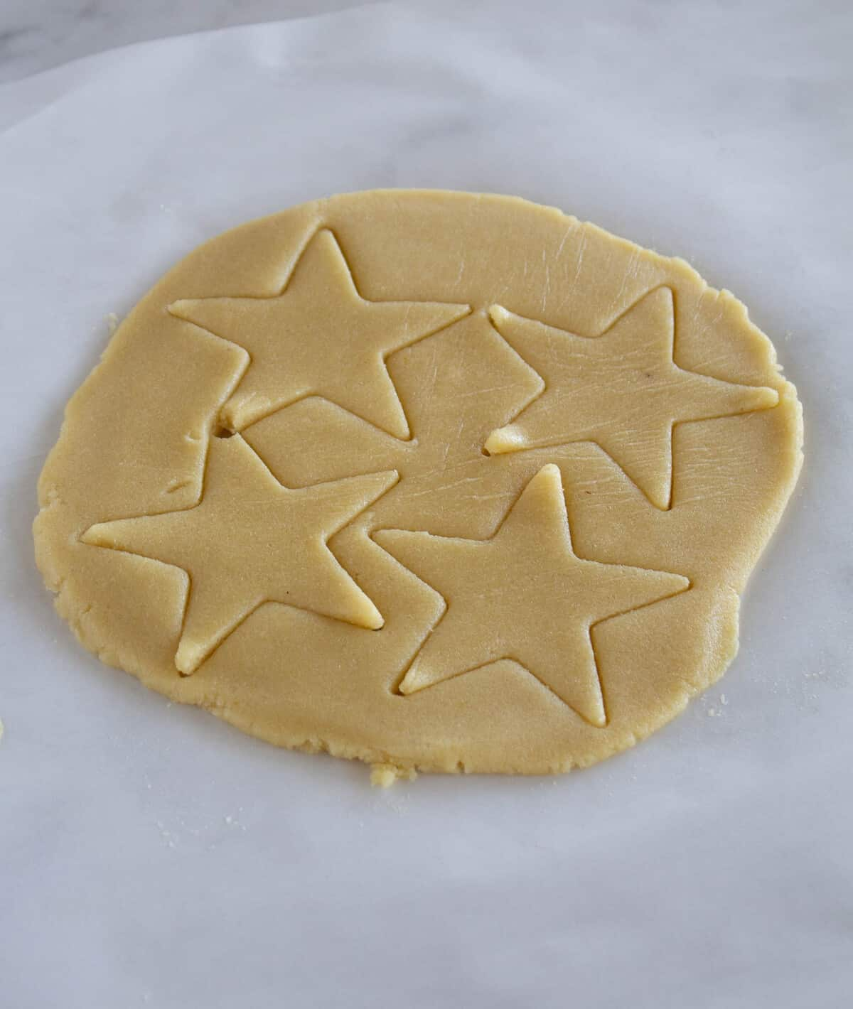Rolled Cookie Dough With Star Shapes In It