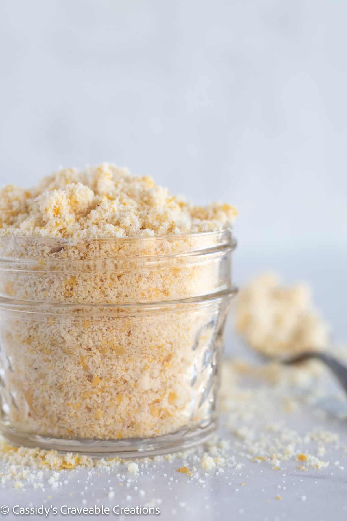 close up of parmesan cheese in mason jar