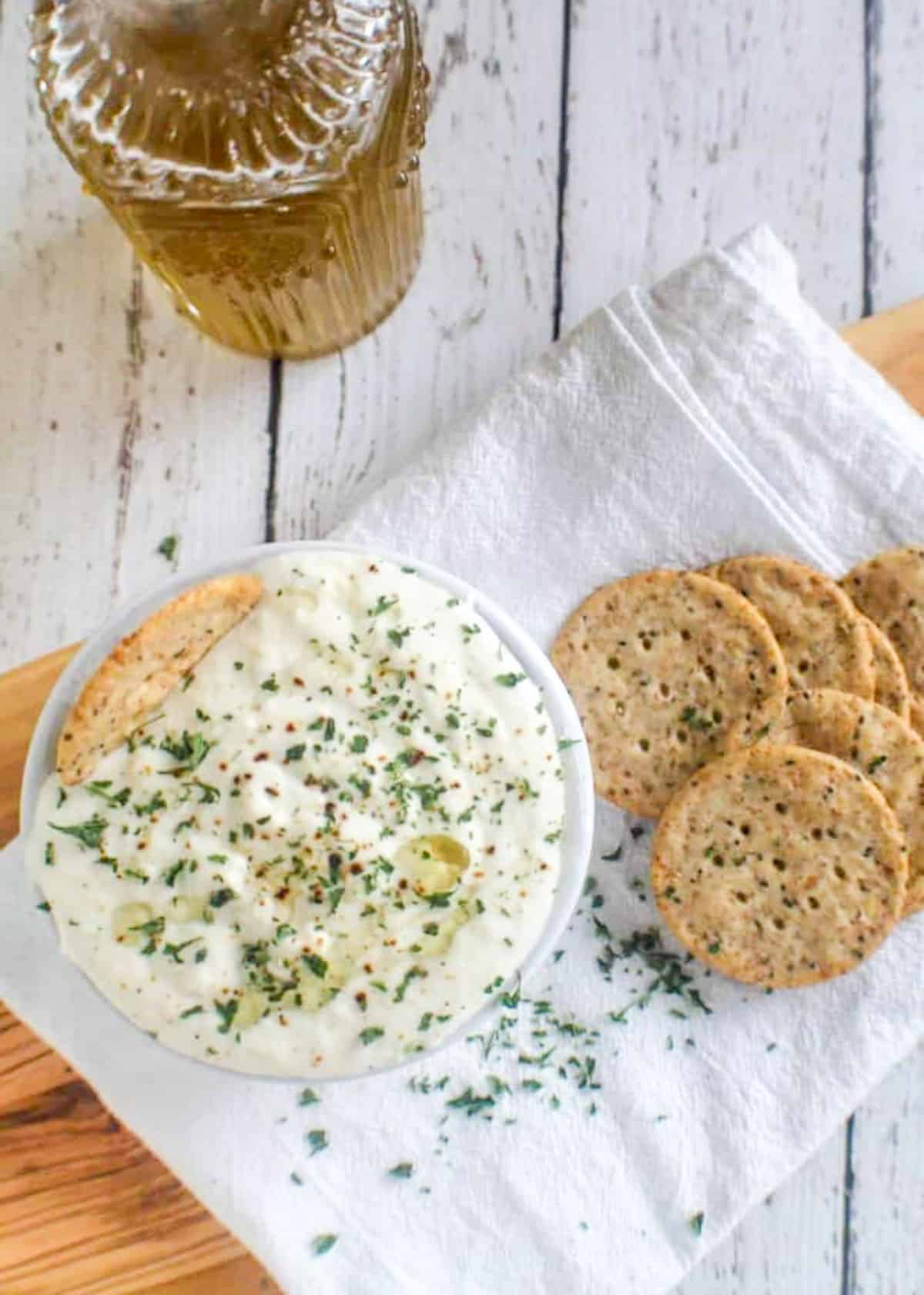 overhead shot of ricotta in bowl with crackers
