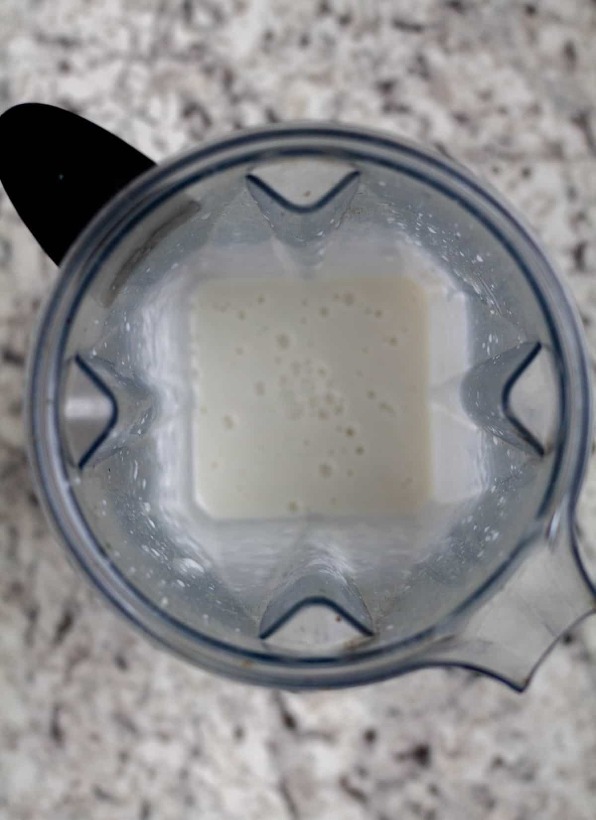 Steamed cauliflower and coconut cream blended in vitamix jar