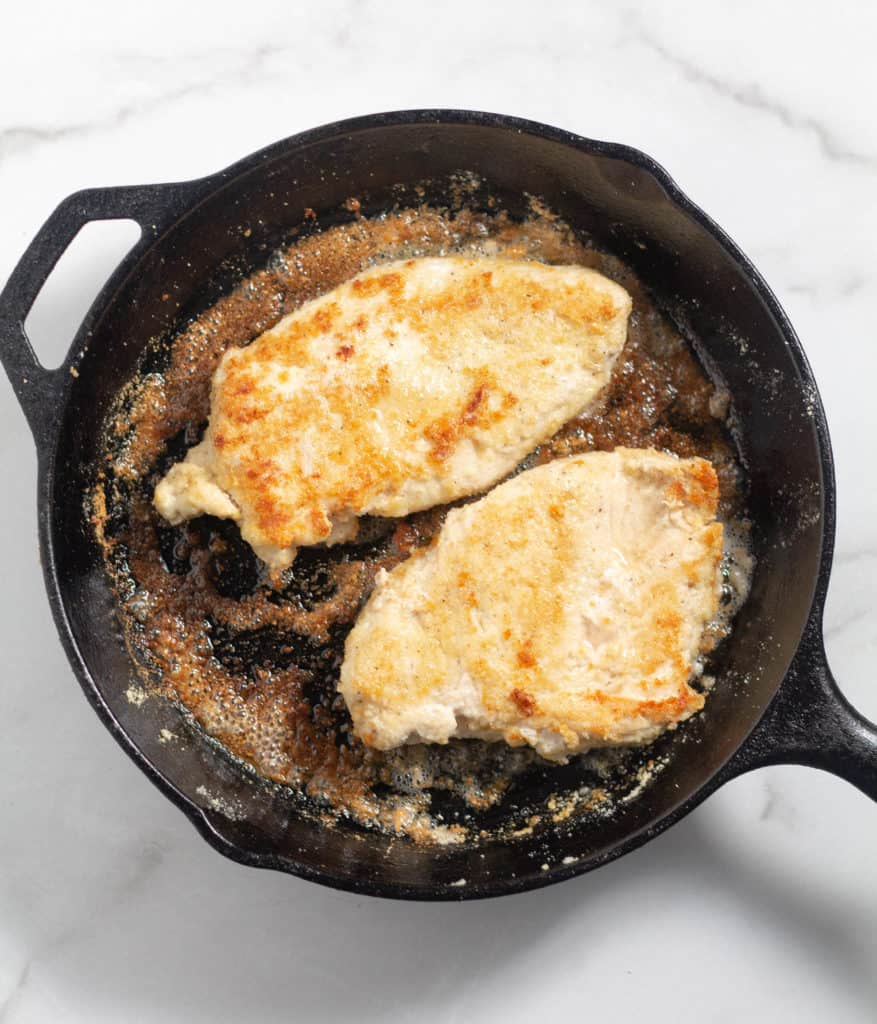 2 grilled chicken breasts in cast iron skillet