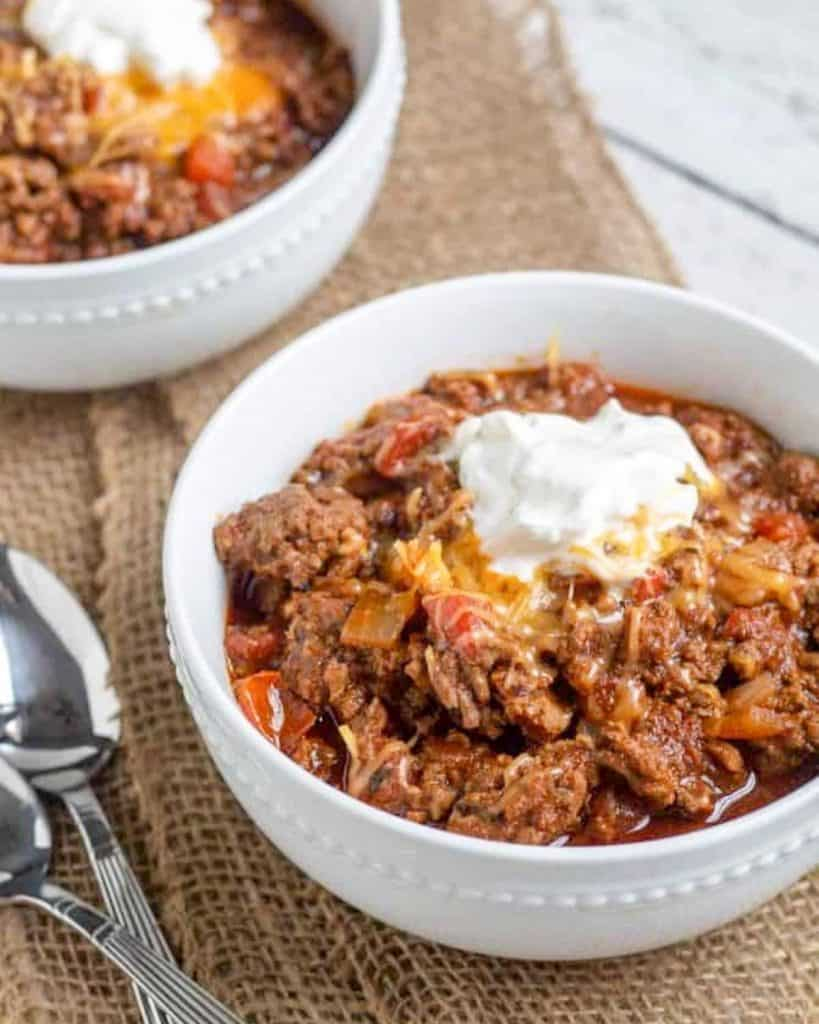 chili in white bowl with garnishes