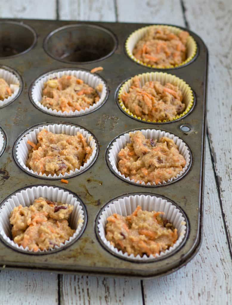Carrot cake batter in muffin tin
