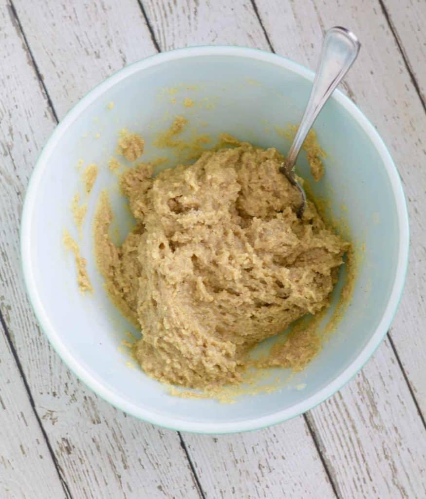 Carrot cake batter mixed together in bowl