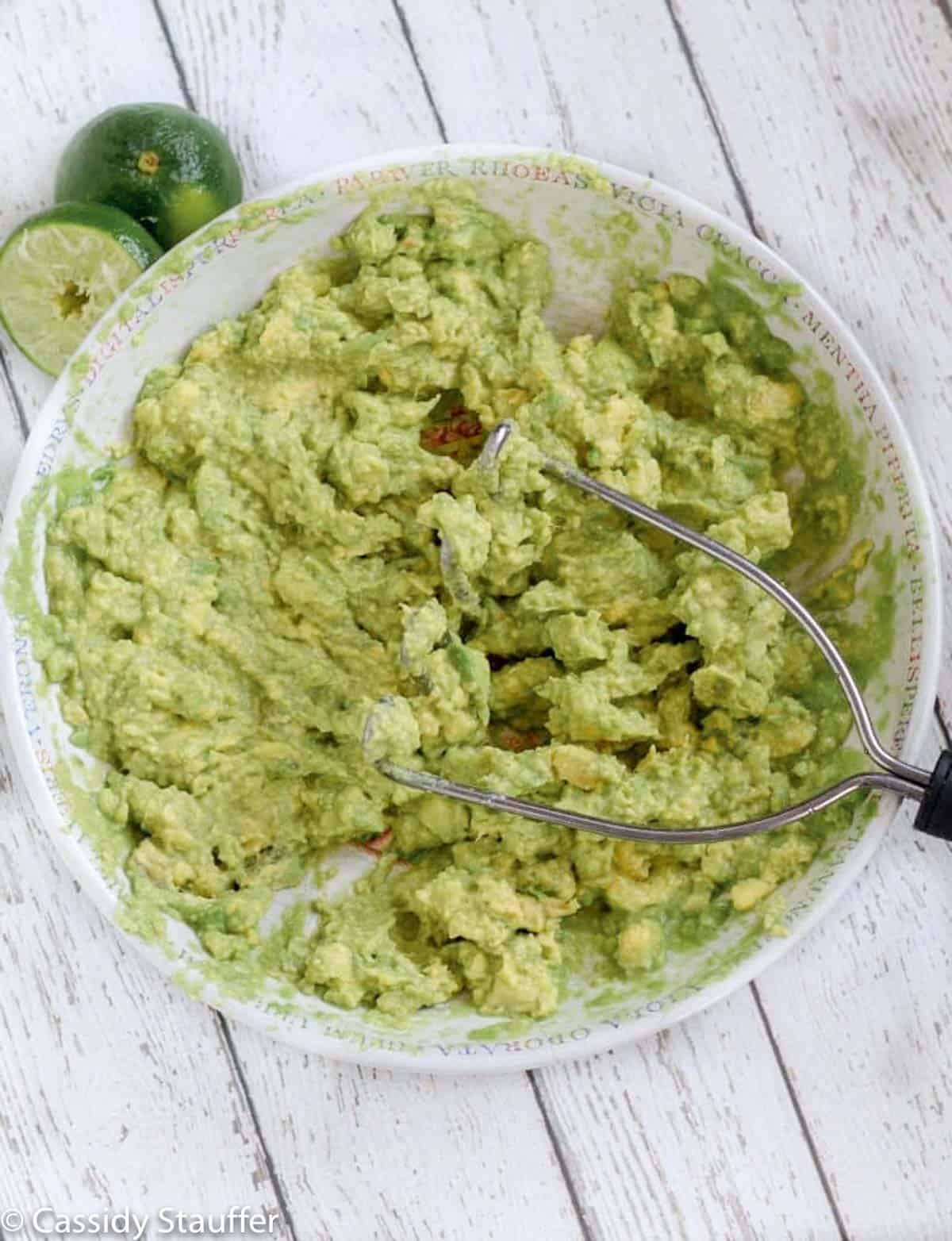 Avocado mashed in a shallow white bowl