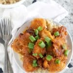 overhead shot of sweet and sour chicken with green onions