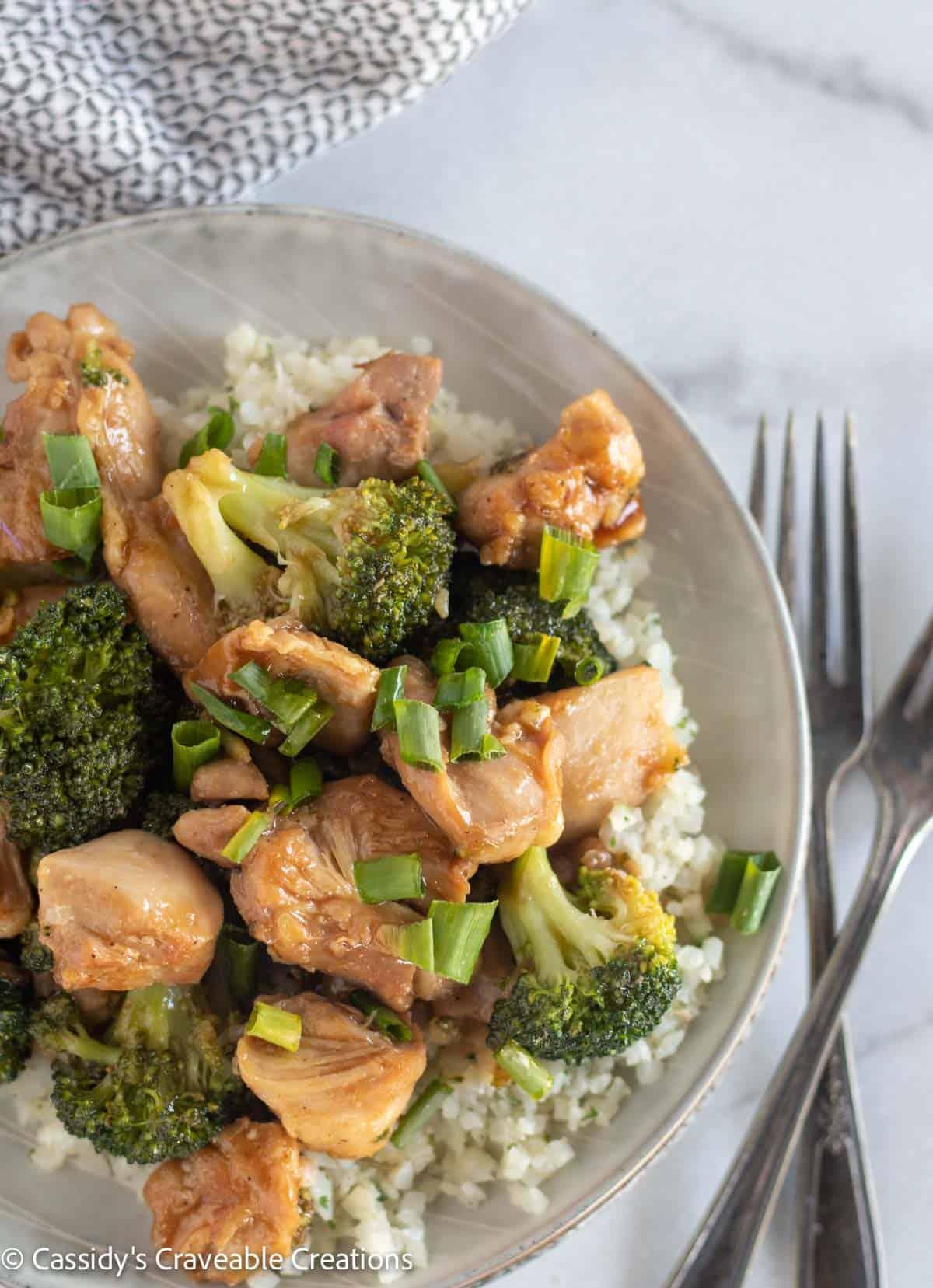 overhead shot of teriyaki chicken over cauliflower rice