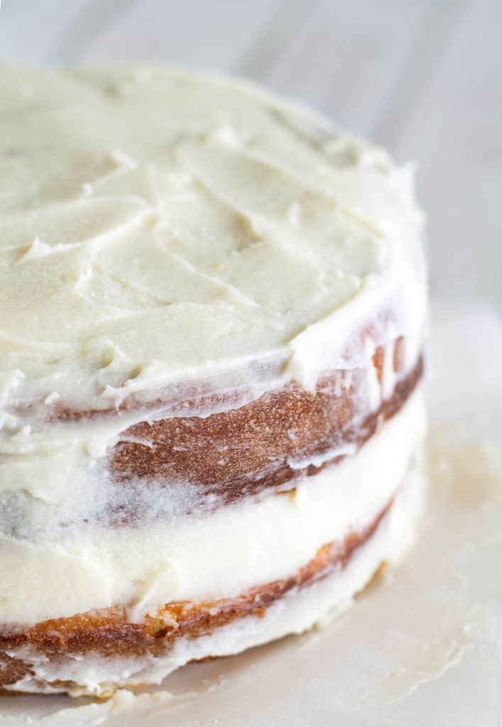 Close up of edge of semi-naked cake