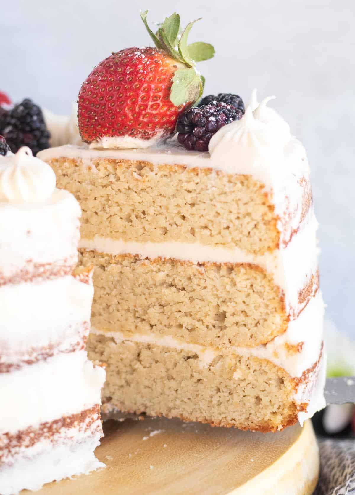 Slice of Keto Vanilla Cake On White Plate With Strawberries