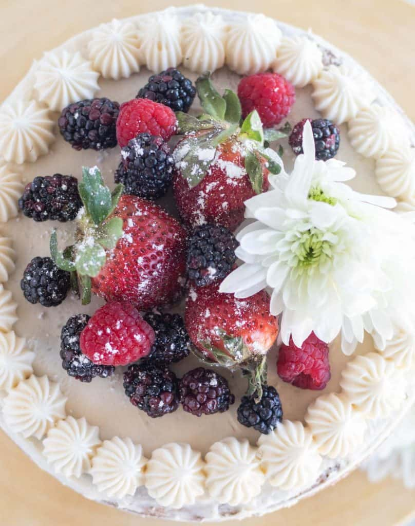 overhead shot of vanilla cake with berries on top
