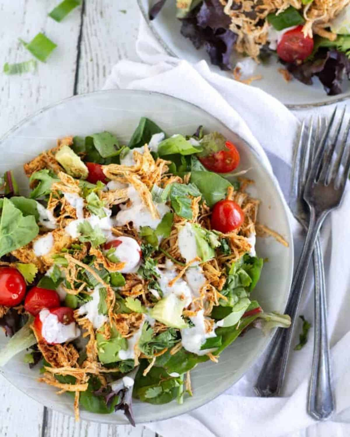 overhead shot of keto chicken taco salad with garnishes