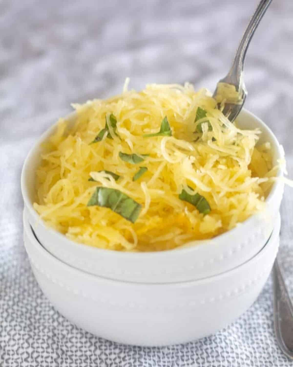 spaghetti squash in bowl with fork