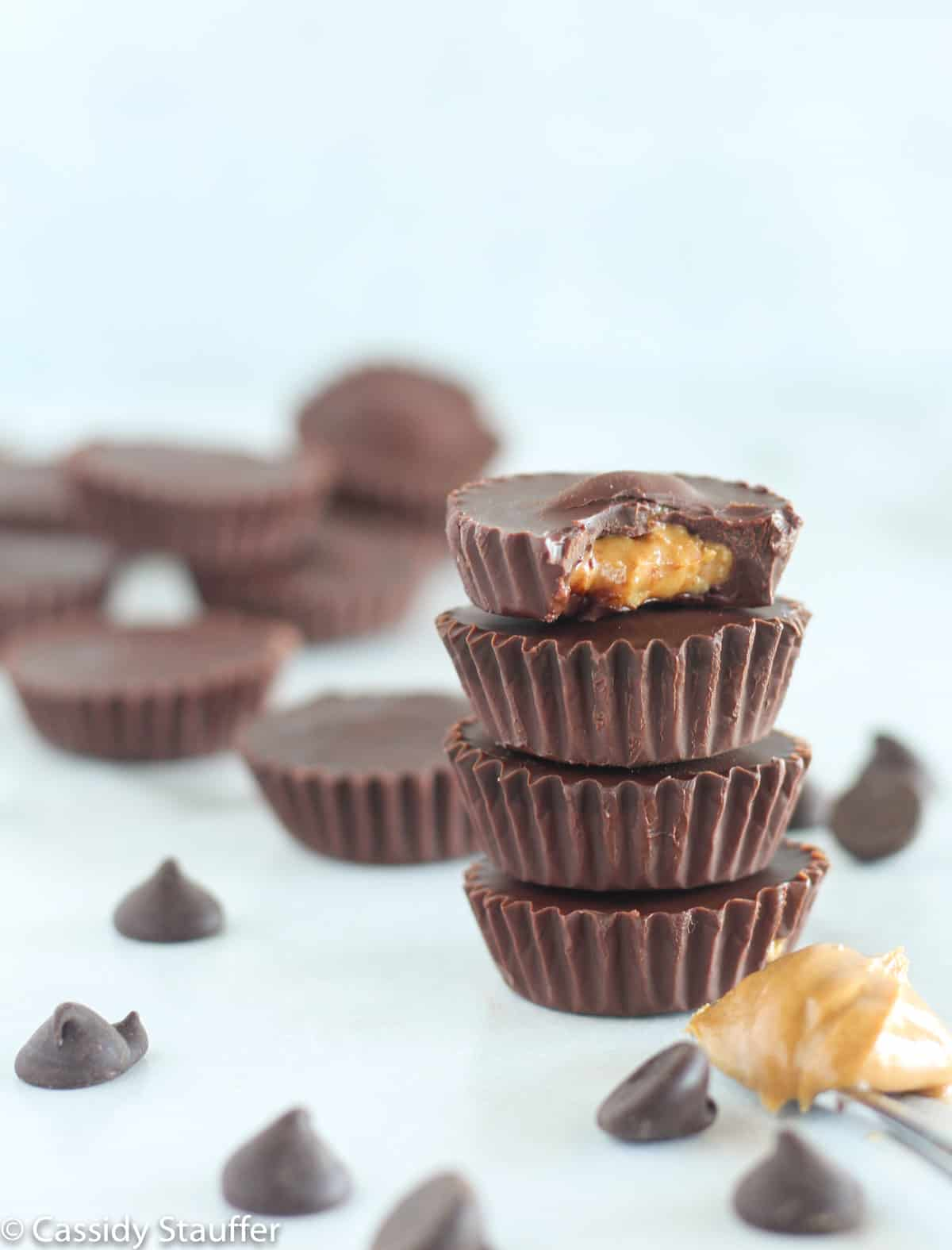 peanut butter cups stacked with bite taken out of top one