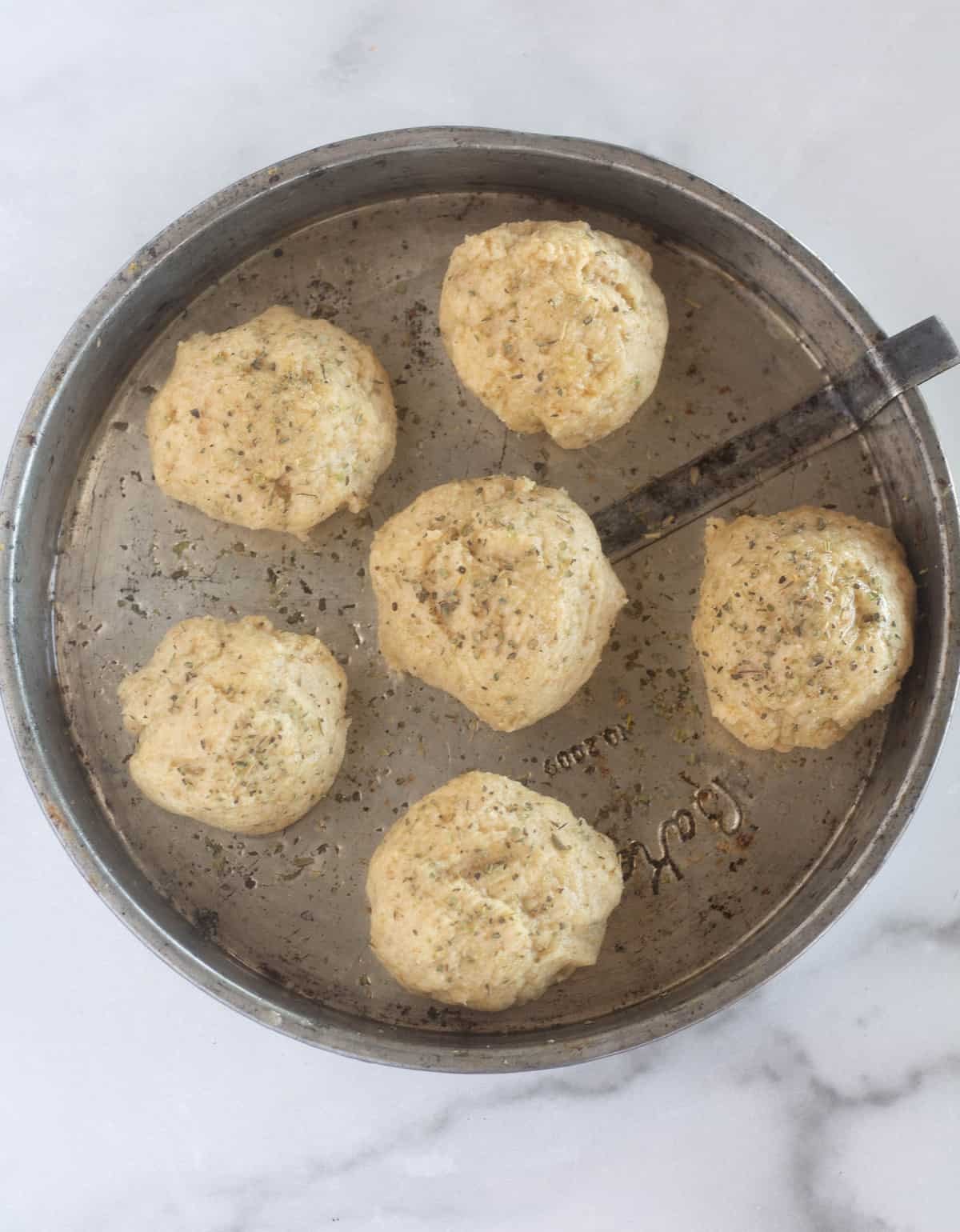 unbaked rolls in pan