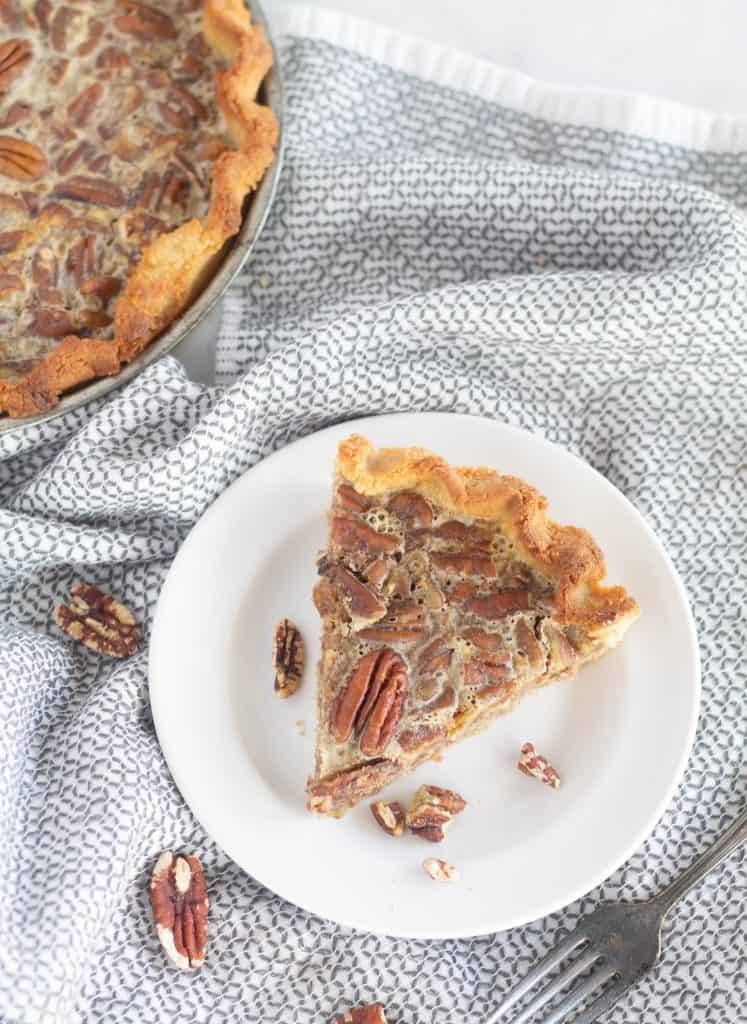 slice of pecan pie on white plate