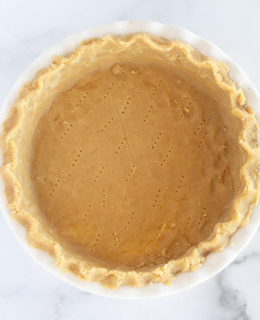 unbaked pie crust in pie dish