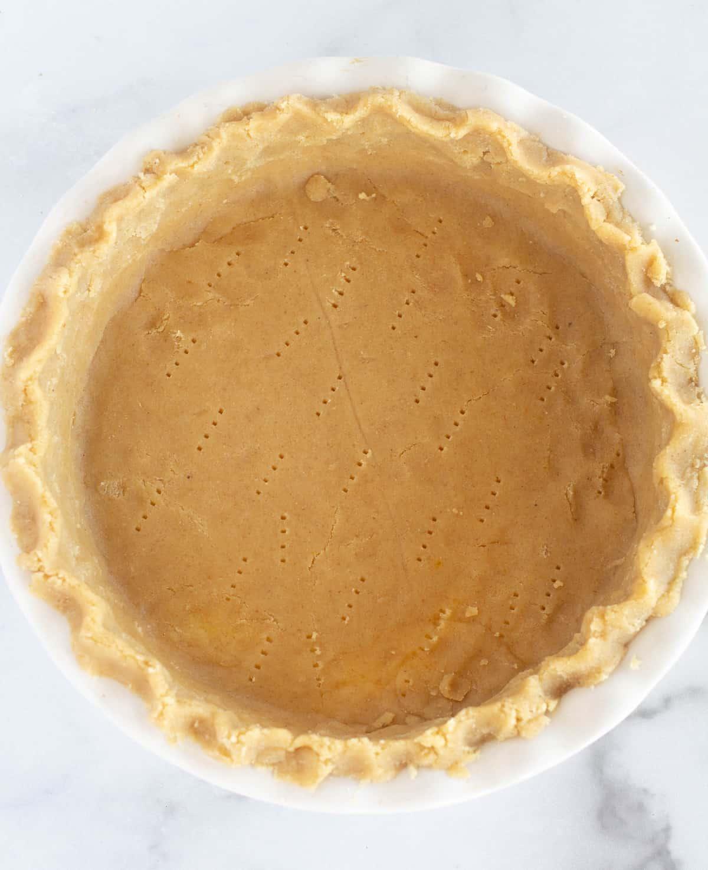 unbaked pie crust in pie dish