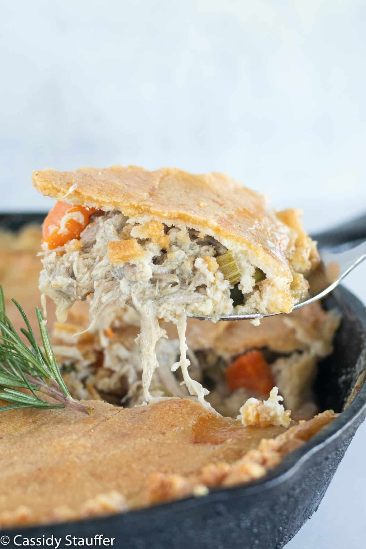 scooping out chicken pot pie