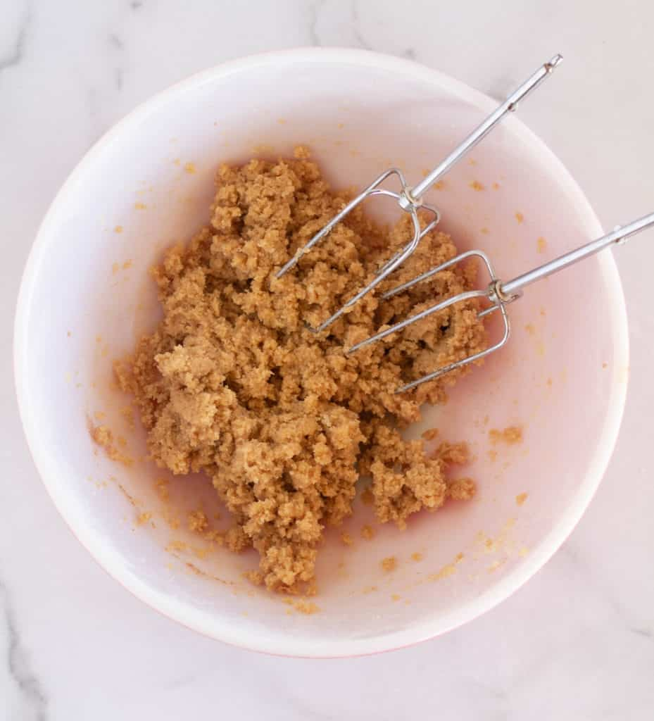 unbaked cookie batter in bow with beaters