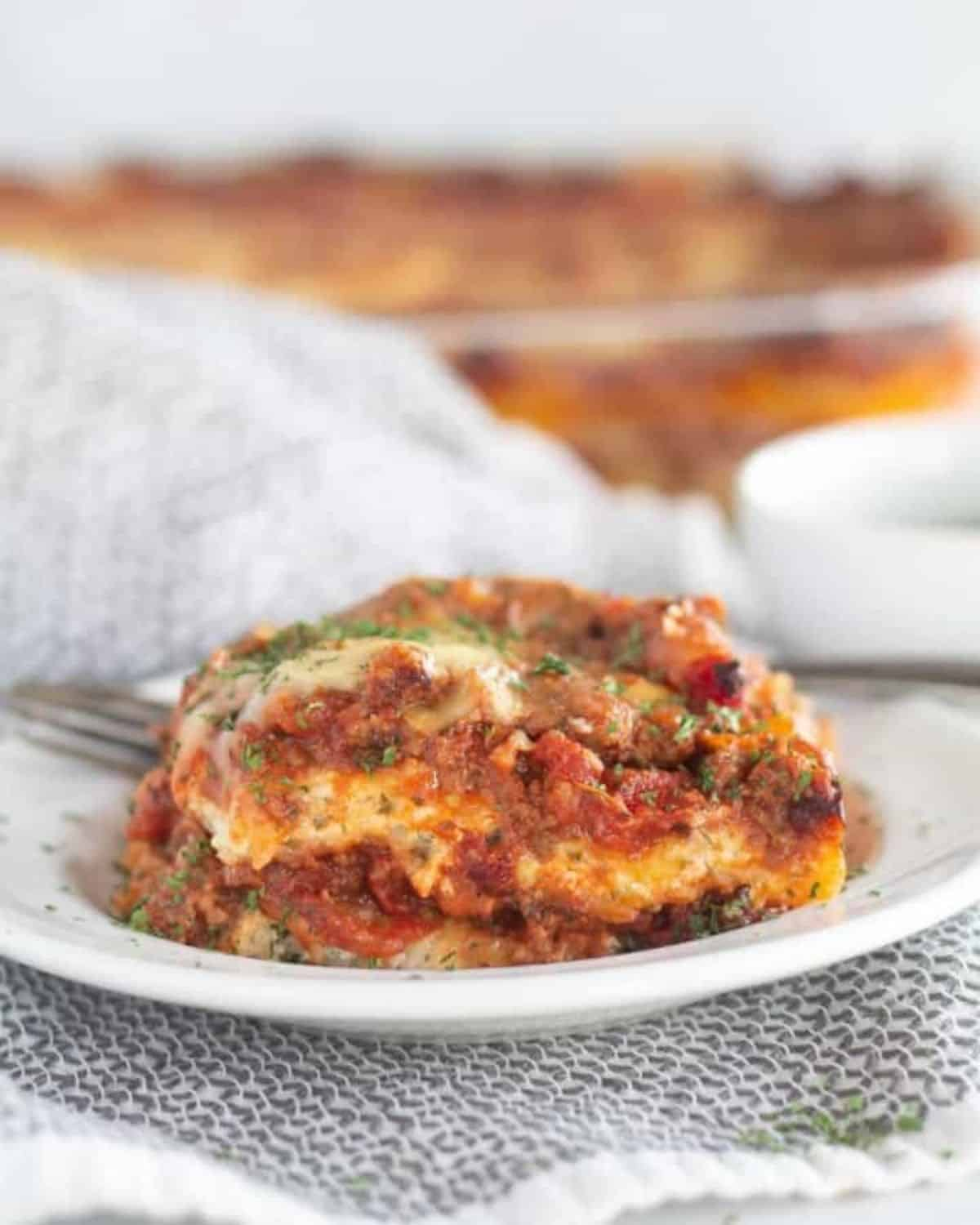 piece of lasagna on white plate