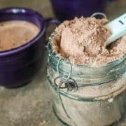 scooping hot chocolate mix out of container