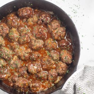 overhead shot of keto sweet and sour meatballs in cast iron skillet