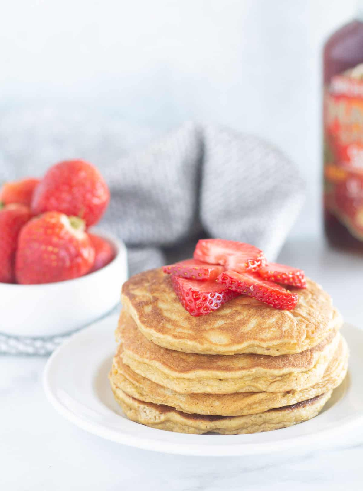 pancakes on white plate with strawberries