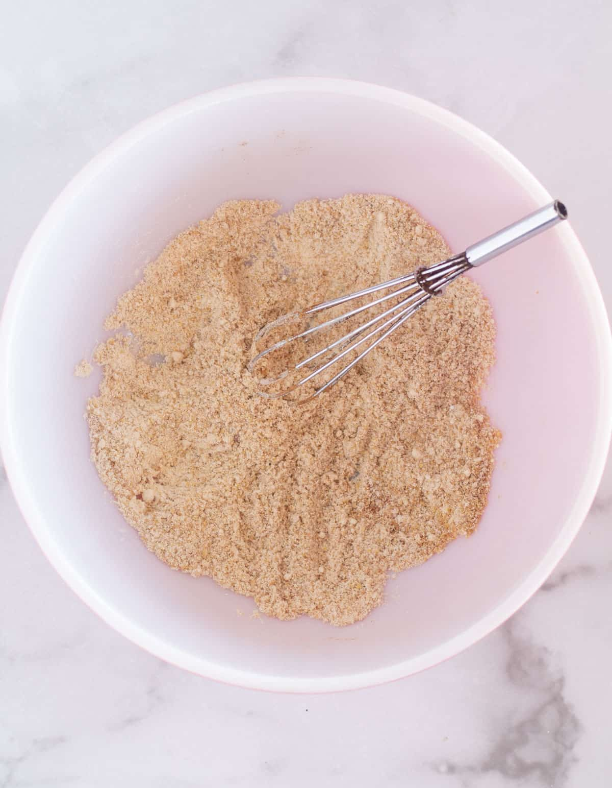 dry ingredients in bowl with whisk