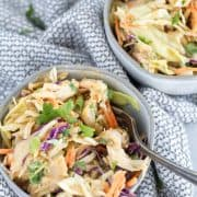 thai chicken salad in 2 bowls with a fork