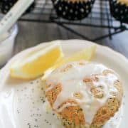 glazed muffin on white plate with poppyseeds