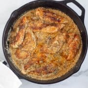 square image of tuscan chicken in skillet