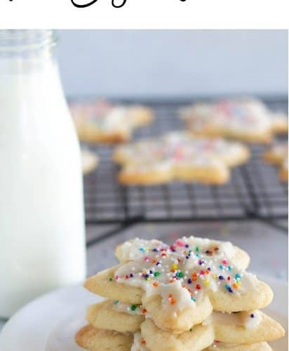 sugar cookies stacked on white plate