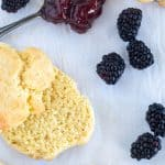 cut biscuit on parchment paper with berries