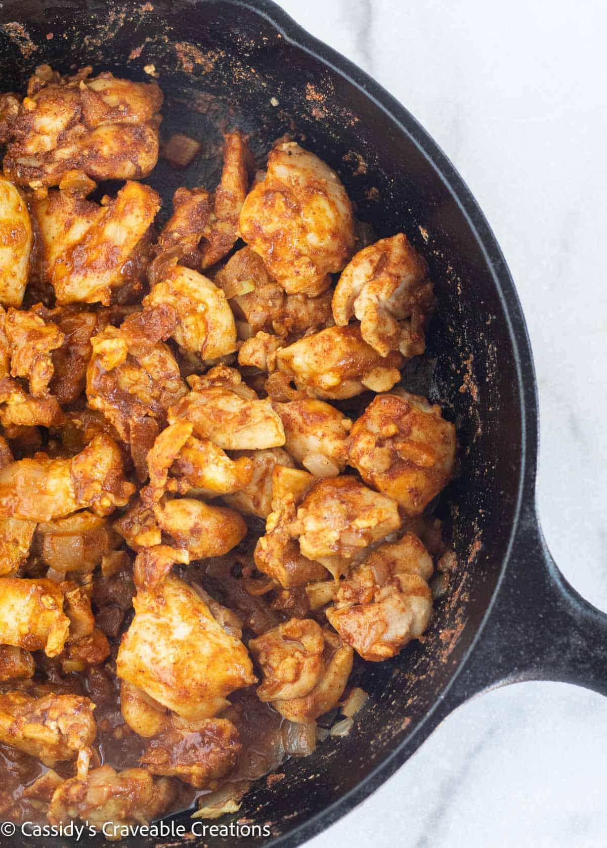 chicken with seasonings in skillet