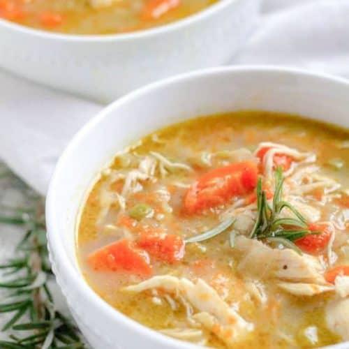 chicken pot pie soup in white bowls