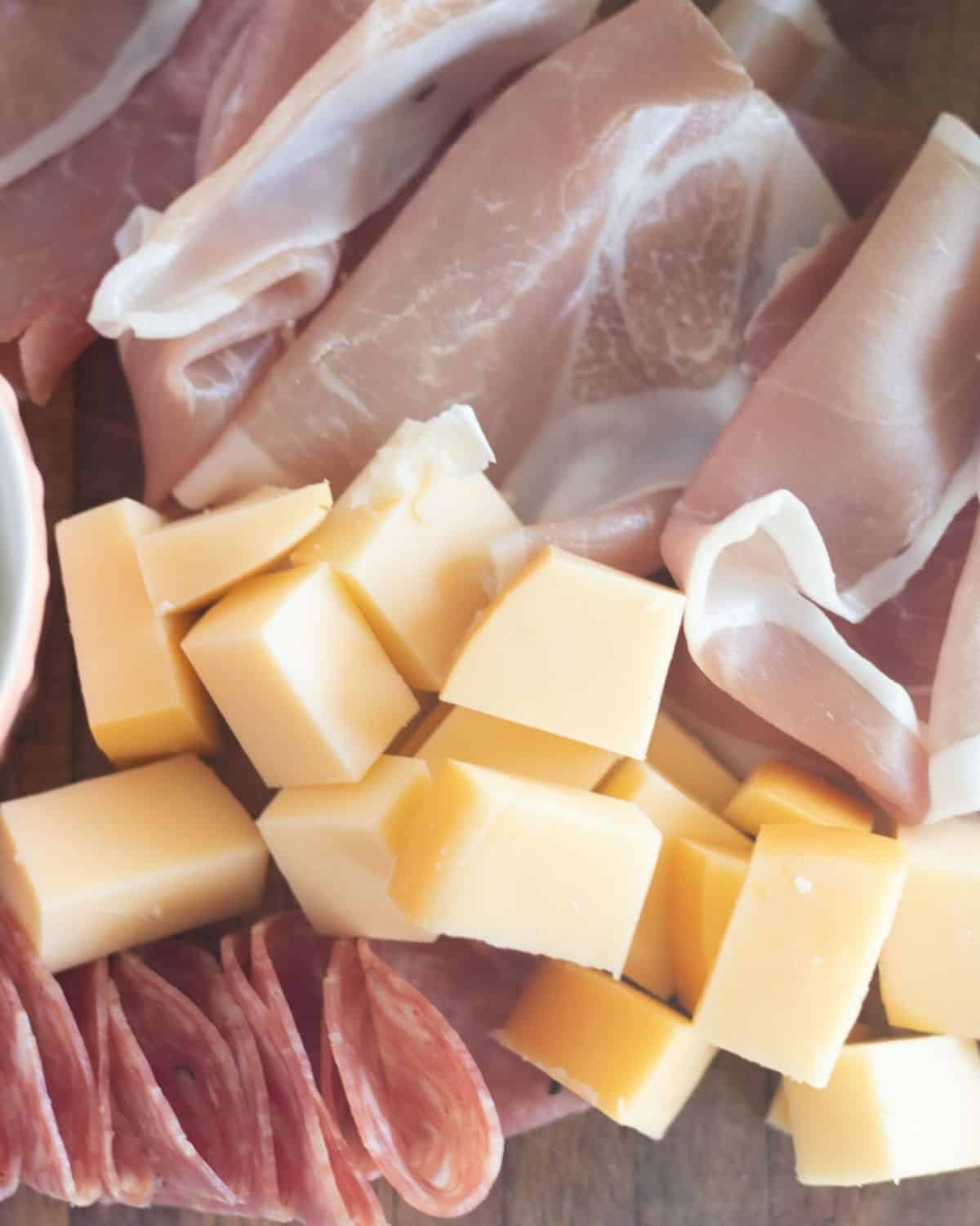 close up of cubed cheese with meats