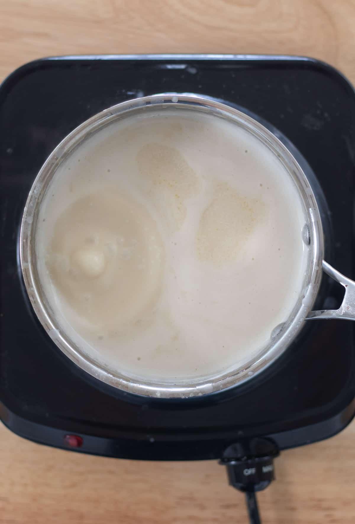 mixture boiling in saucepan