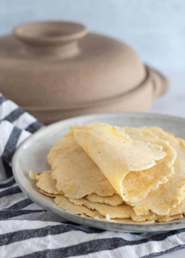 tortillas on plate with the top one folded